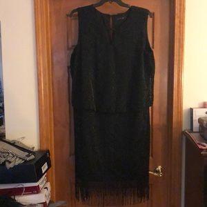 Black dress with sparkle and fringe.